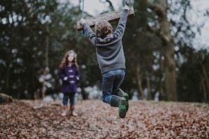 Boy playing on swing