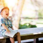 Laughing boy reading