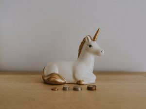 unicorn guarding coins