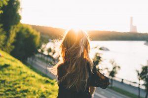 woman facing afternoon sun