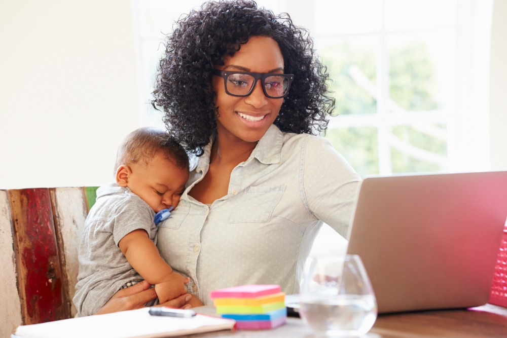 happy business-owning mom with child