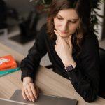 thinking woman on laptop