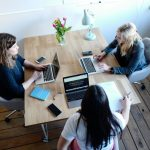 three women working on digital products