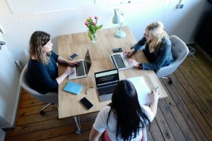 three women working on digital products