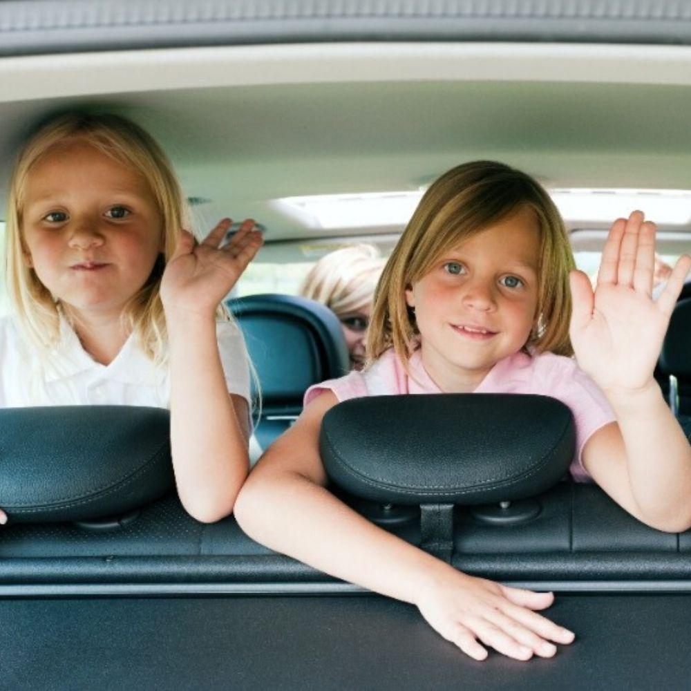 two girls backseat of car